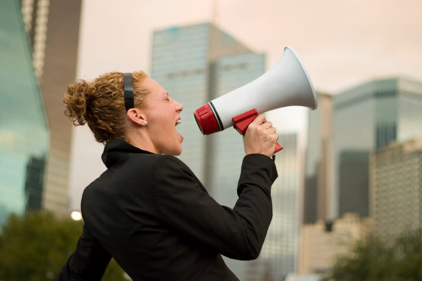 Woman letting the world know via megaphone