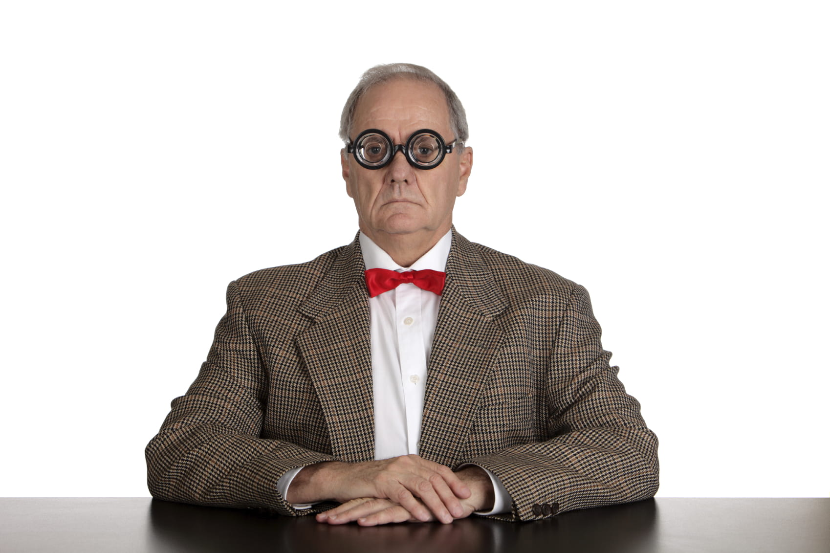 Old white man in tweed and bottle spectacles